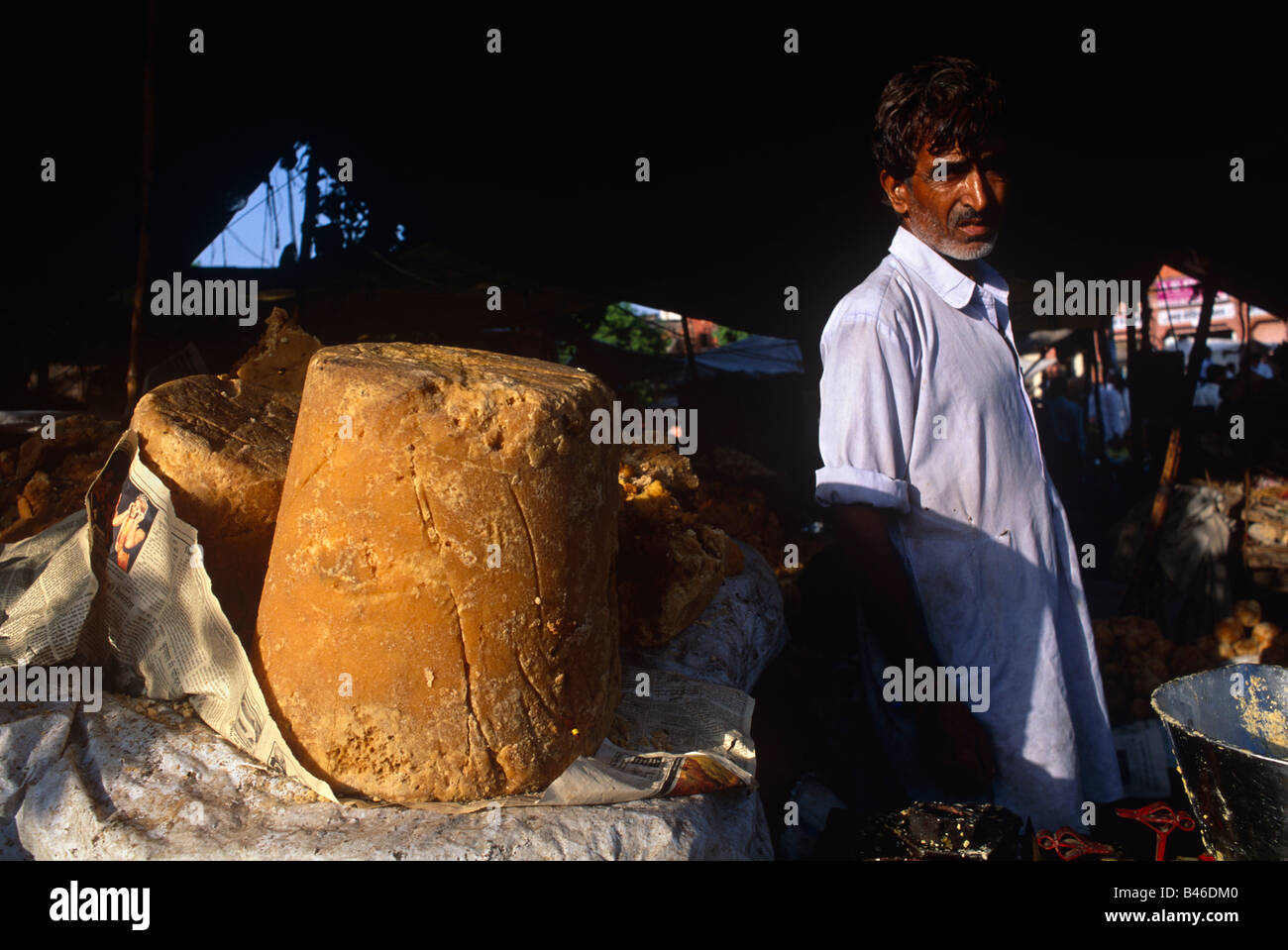 Foodstall Awning Man Standing By Pillar Of Brown Sugar Palm JAIPUR RAJASTHAN INDIA