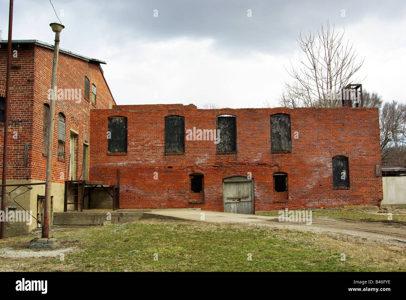 An Old Abandoned Factory Building Made Of Red Brick