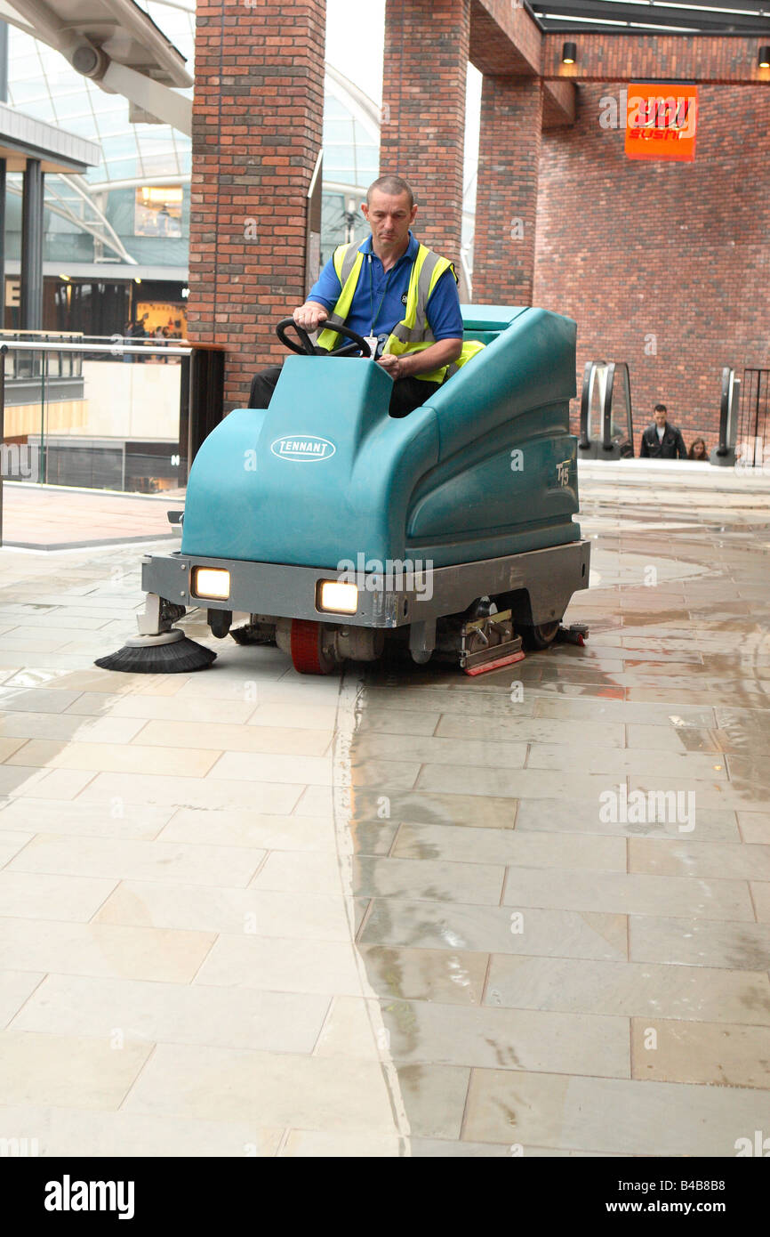Cleaner Driving A Machine To Wash And Clean The Stone