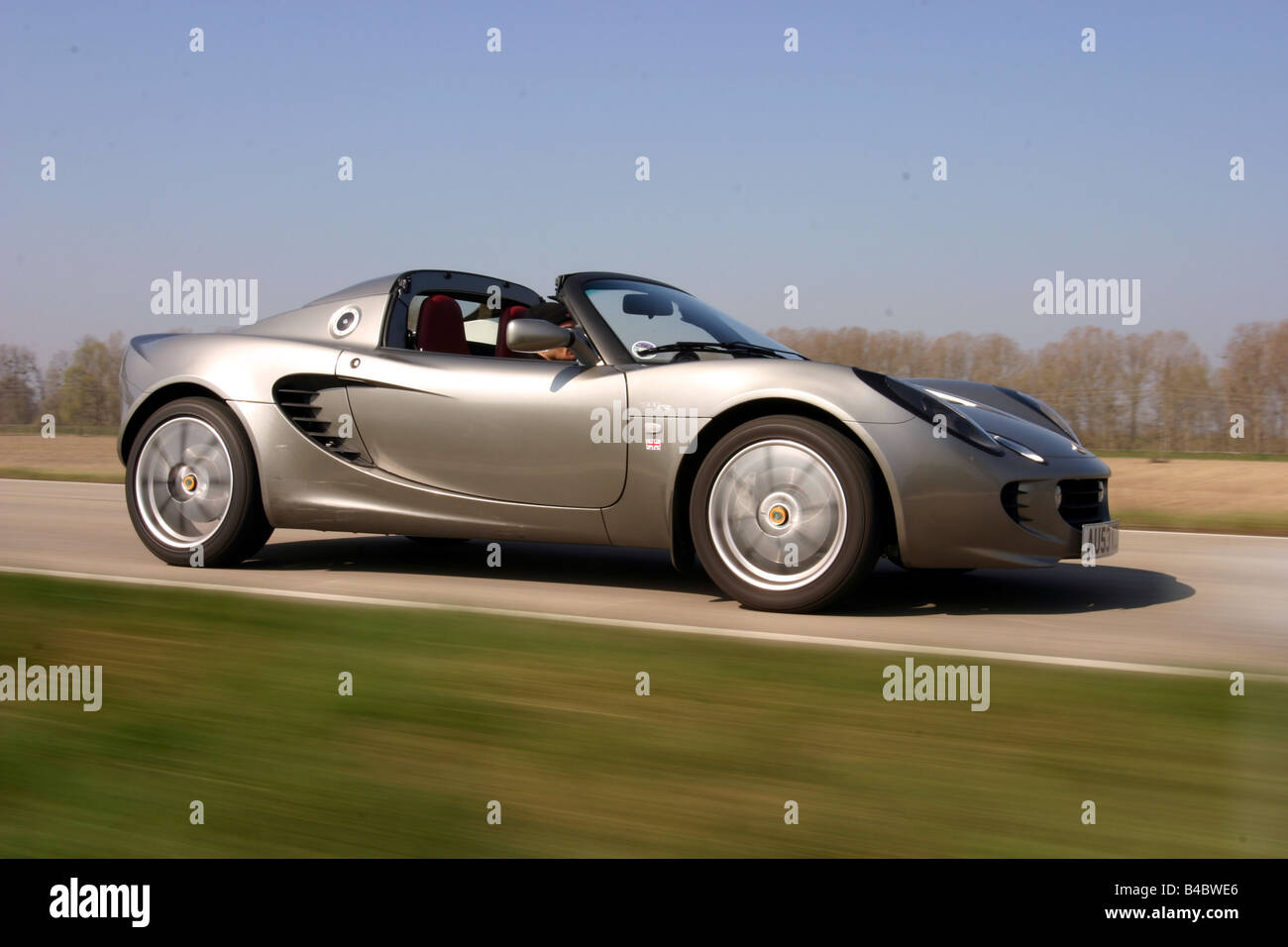 http://c8.alamy.com/comp/B4BWE6/car-lotus-elise-111-r-convertible-model-year-2004-open-top-driving-B4BWE6.jpg