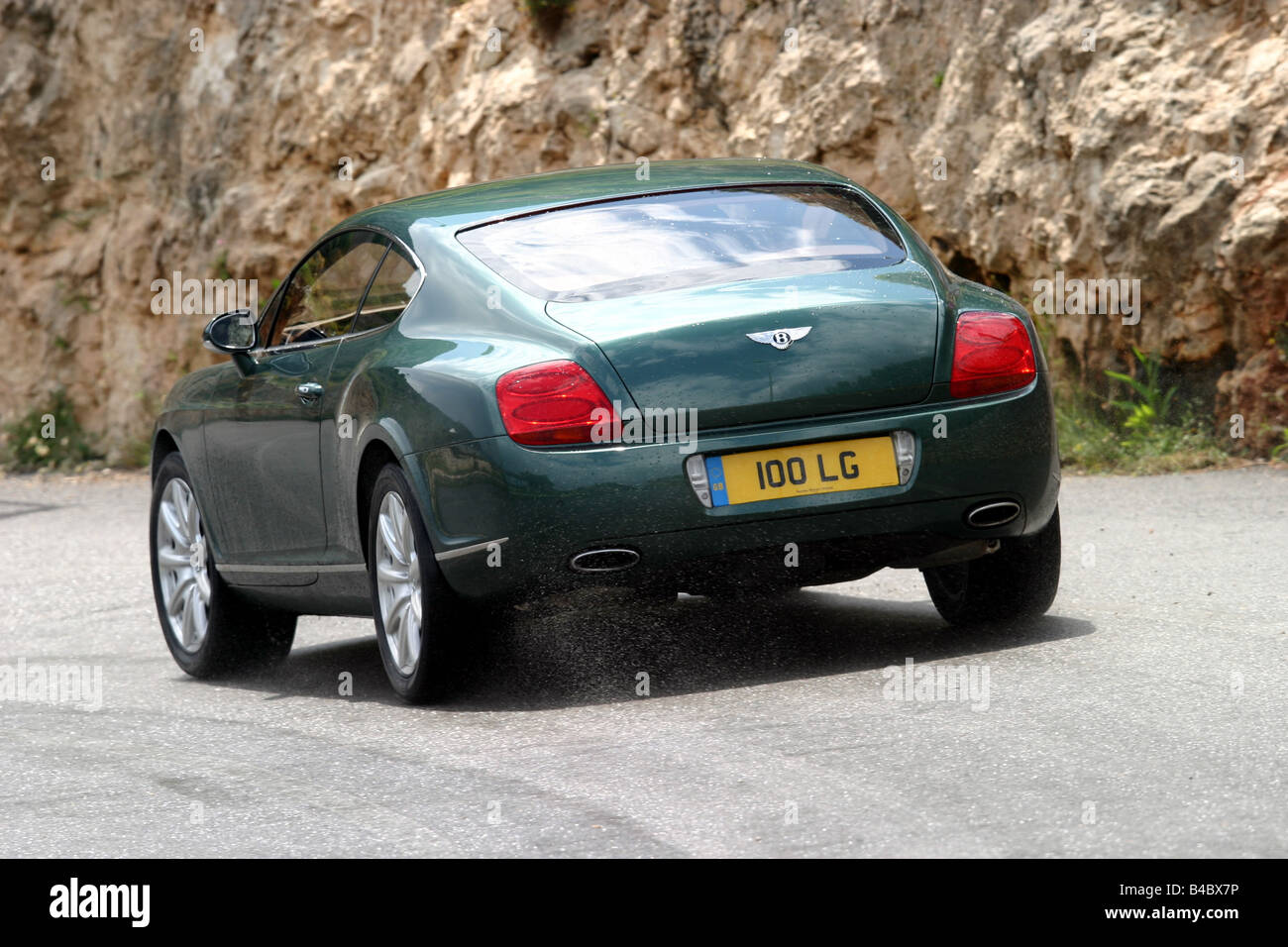 Car bentley continental gt roadster model year 2003 coupe car bentley continental gt roadster model year 2003 coupecoupe dark green driving diagonal from the back rear view co vanachro Gallery