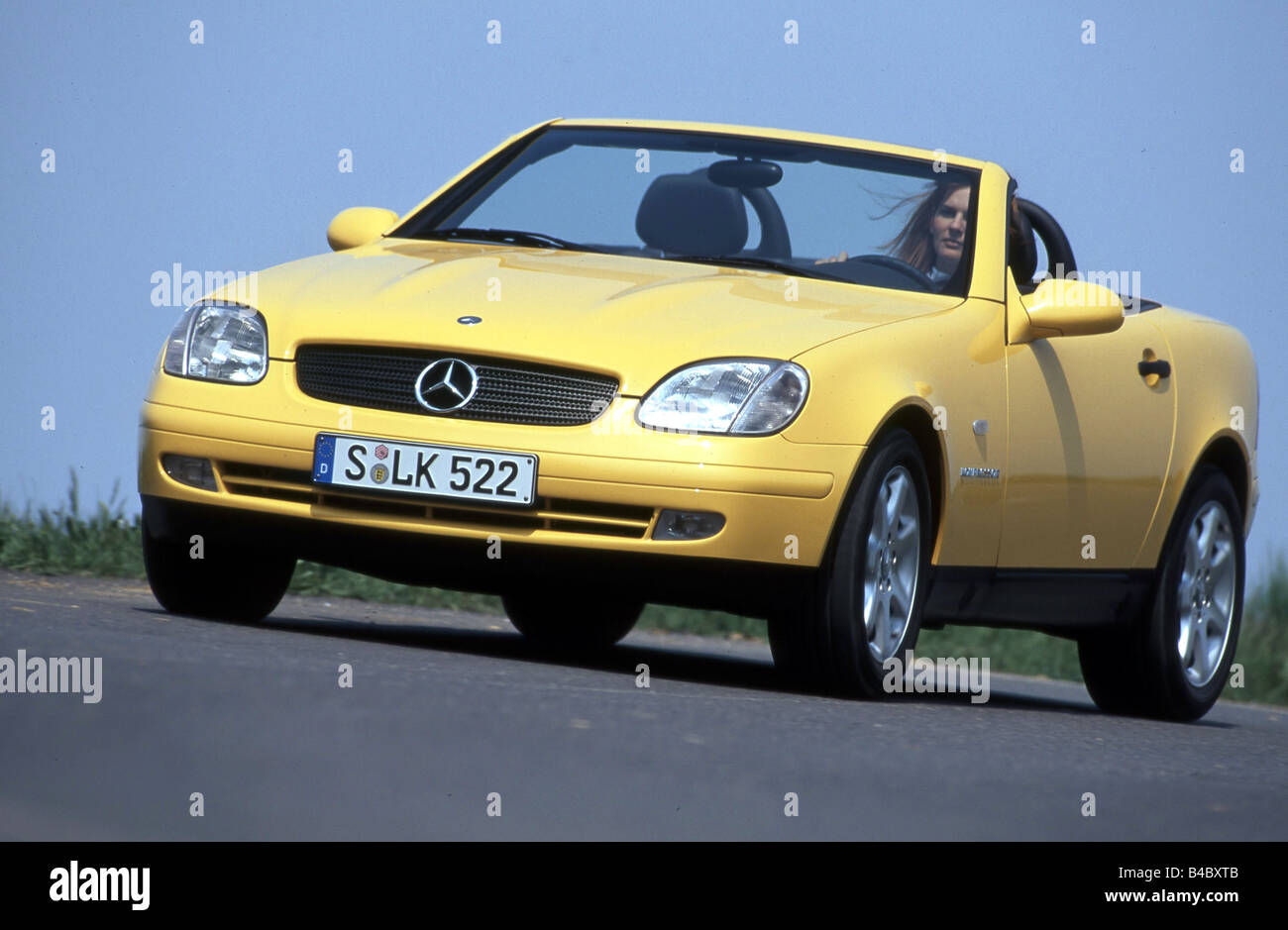 car mercedes slk convertible model year 1996 2000 yellow open stock photo royalty free. Black Bedroom Furniture Sets. Home Design Ideas
