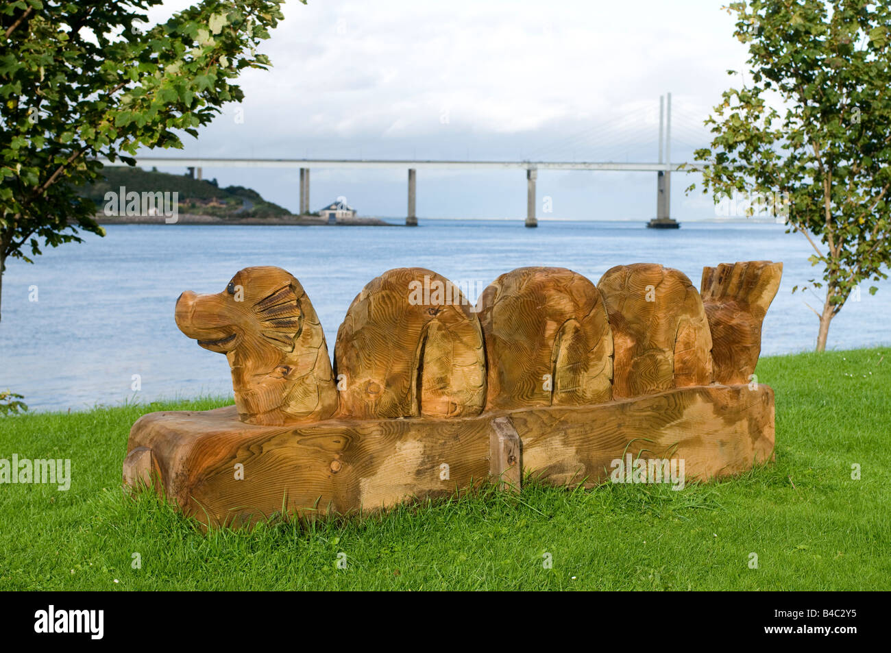 Wooden chainsaw sculpture of nessie loch ness monster at