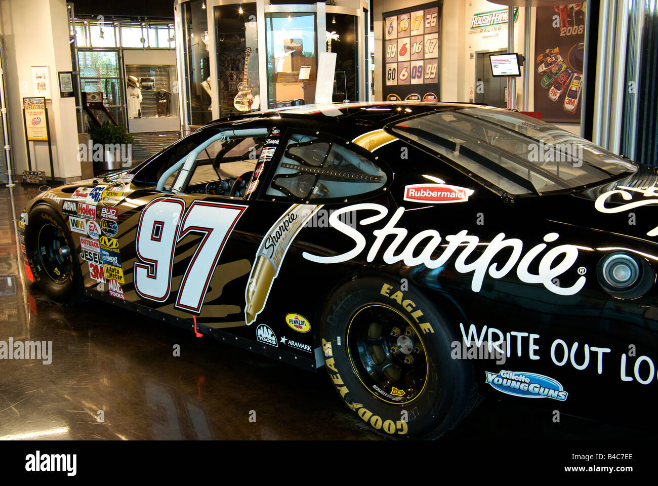 A Ford Taurus Nascar Race Car Covered In Sponsor Decals At The