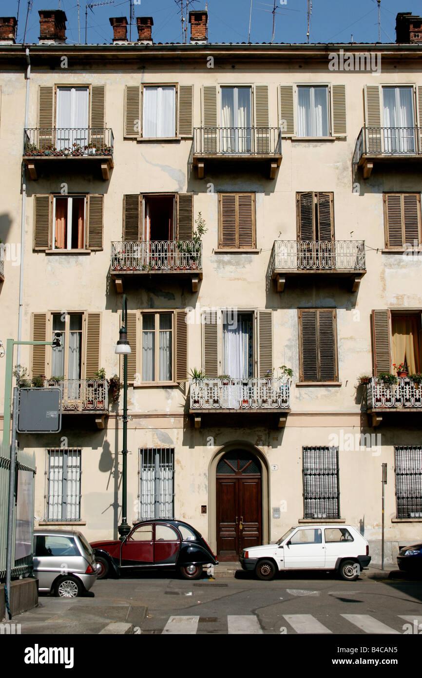 old cars parked in via gaudenzio ferrari in turin, near the mole