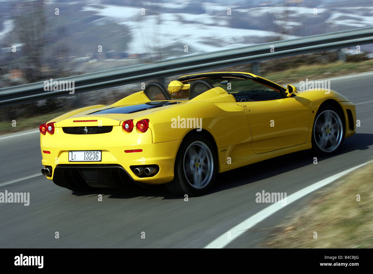 Car ferrari f430 spider model year 2005 yellow convertible car ferrari f430 spider model year 2005 yellow convertible driving diagonal from the back rear view open top country r vanachro Choice Image