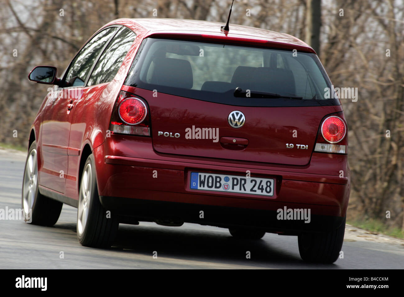 car vw volkswagen polo 1 4 tdi model year 2005 ruby colored stock photo royalty free image. Black Bedroom Furniture Sets. Home Design Ideas