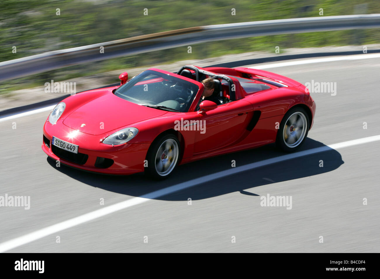 Car, Porsche Carrera GT, Model Year 2005 , Red, Convertible, Open Top,  Driving, Diagonal From The Front, Side View, Country Road