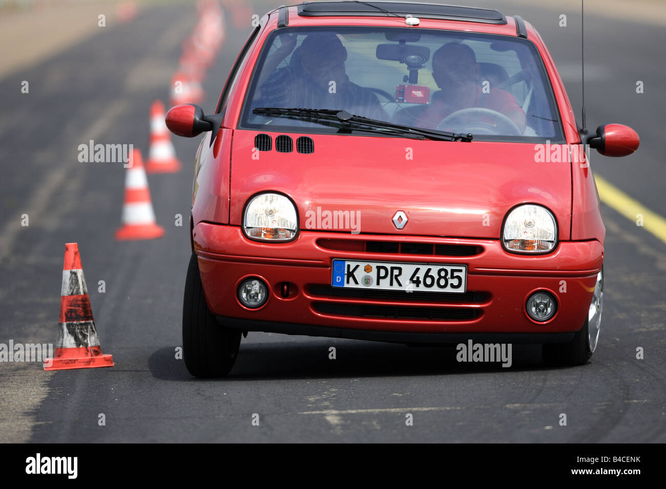 car renault twingo 1 2 dynamique red model year 2000 driving stock photo royalty free. Black Bedroom Furniture Sets. Home Design Ideas
