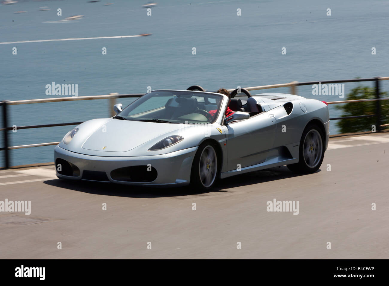 Car ferrari f430 spider f1 model year 2005 silver convertible car ferrari f430 spider f1 model year 2005 silver convertible driving diagonal from the front frontal view country road vanachro Choice Image
