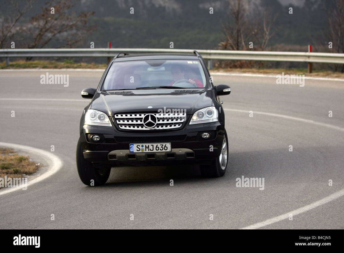 mercedes ml 320 cdi model year 2005 black driving diagonal from stock photo royalty free. Black Bedroom Furniture Sets. Home Design Ideas