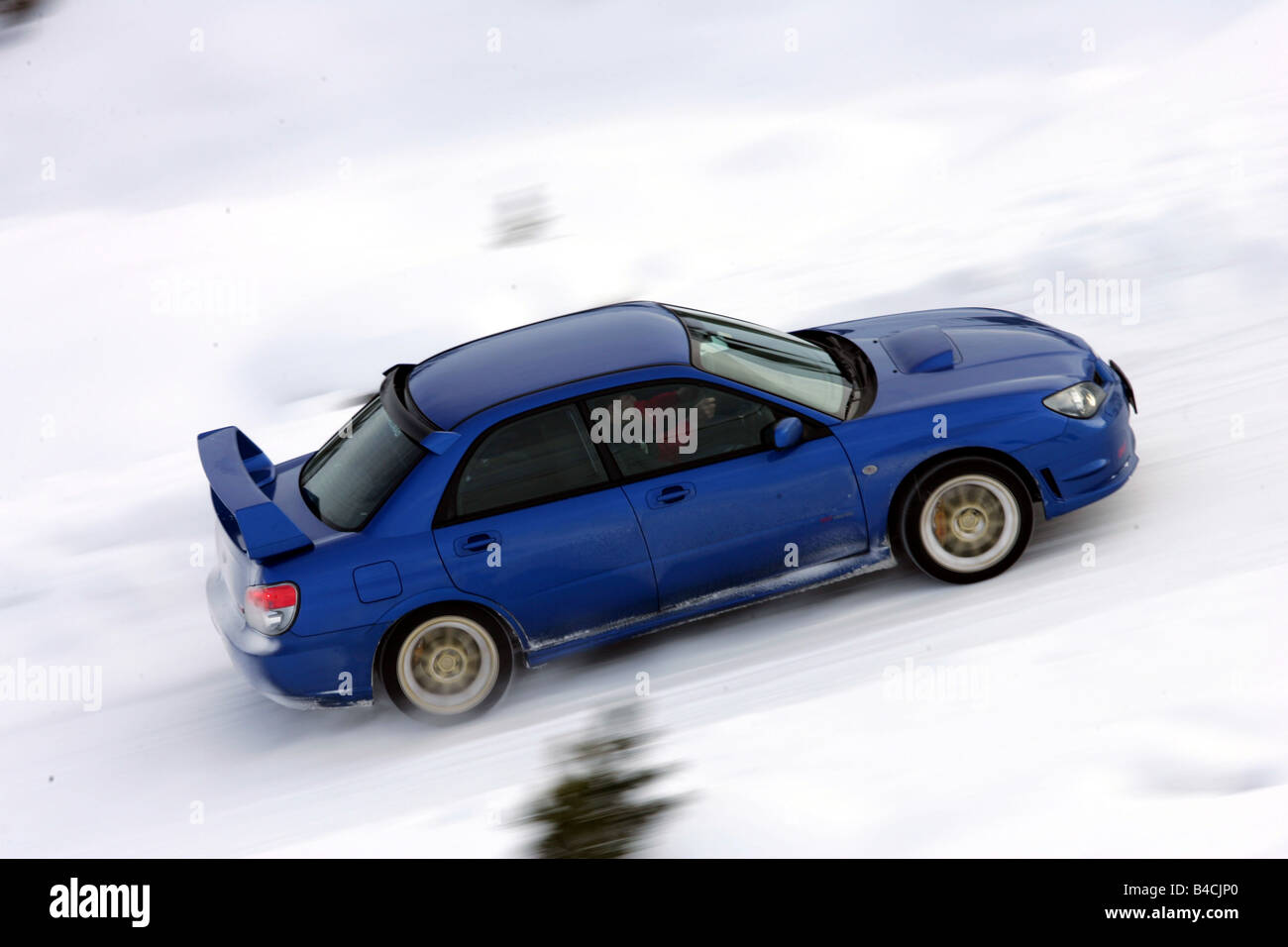 Subaru Impreza 2.5 WRX STi, model year 2005-, blue moving, side ...