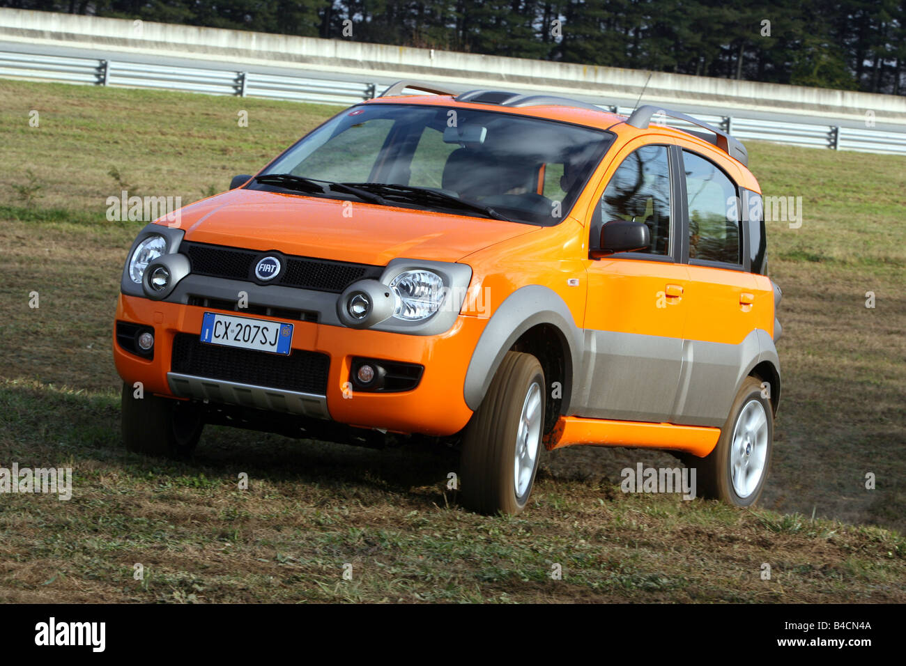 fiat panda 1 3 multijet 16v 4x4 model year 2006 orange driving stock photo royalty free. Black Bedroom Furniture Sets. Home Design Ideas