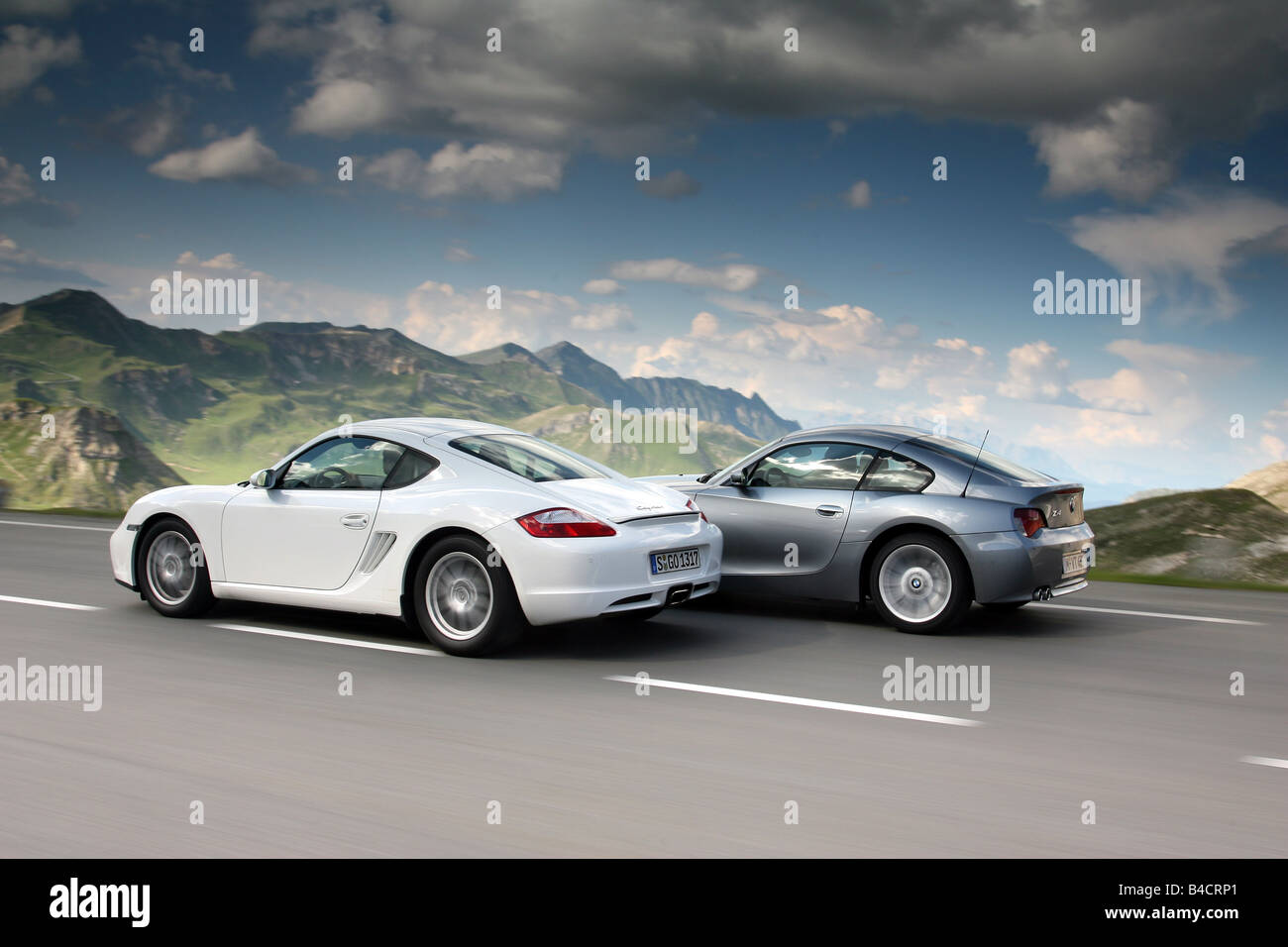 Porsche Cayman Model Year 2006 White Overtakes A Bmw