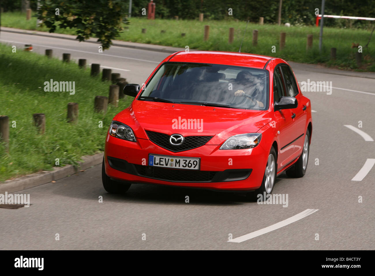mazda 3 sport 1.4 mzr, model year 2003-, red, driving, diagonal