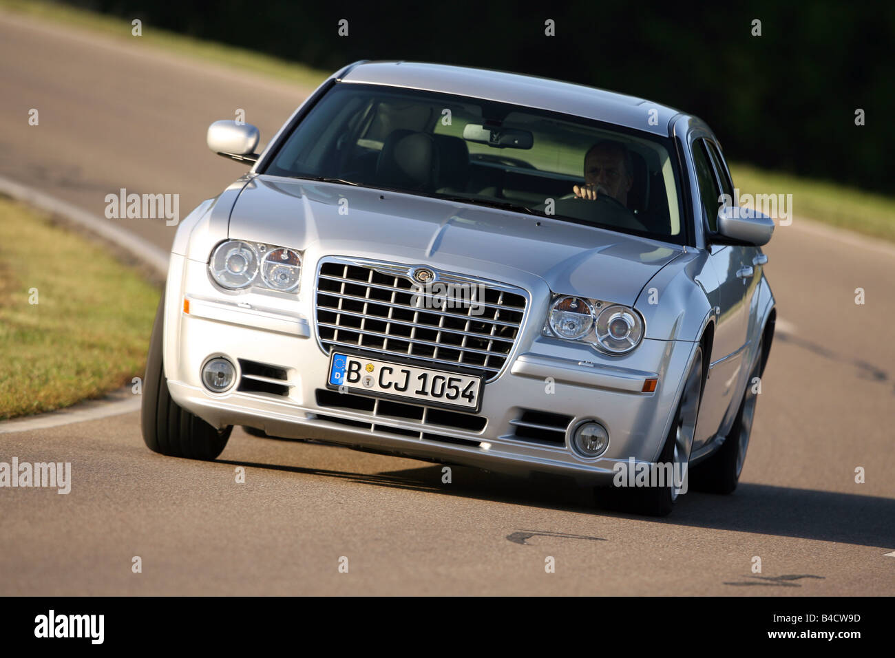 chrysler 300 2006 silver. chrysler 300c touring srt8 model year 2006 silver driving diagonal from the front frontal view country road 300