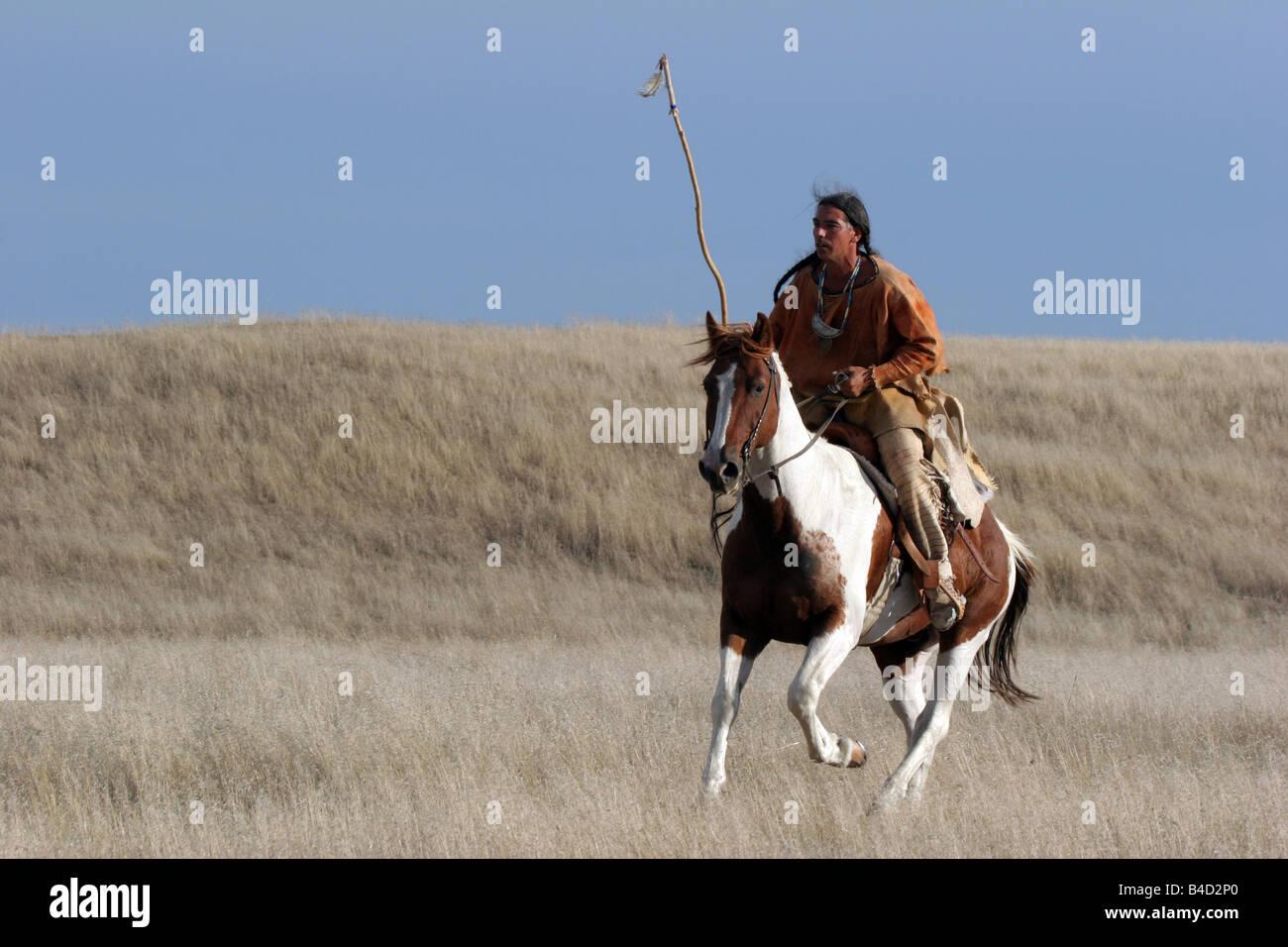 A Native American Lakota Sioux Indian riding horseback on ...