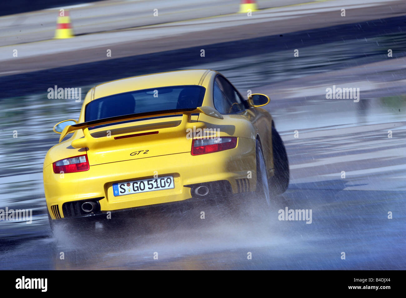 porsche 911 gt2 model year 2007 yellow driving diagonal from the stock photo royalty free. Black Bedroom Furniture Sets. Home Design Ideas