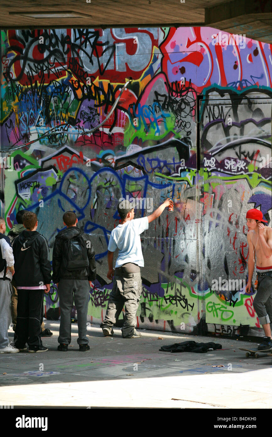 Graffiti wall chelmsford - Group Of Young Boys Men Teenagers Hoodies Yobs Skaters Watch A Graffiti Artist At Work Spraying