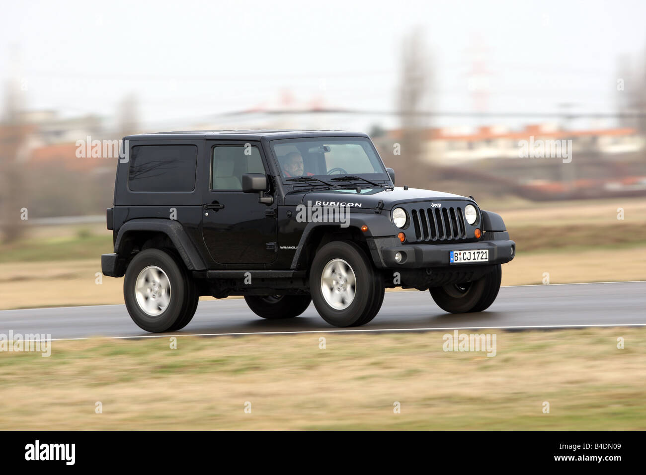 jeep wrangler rubicon 3 8 model year 2008 black driving diagonal stock photo royalty free. Black Bedroom Furniture Sets. Home Design Ideas