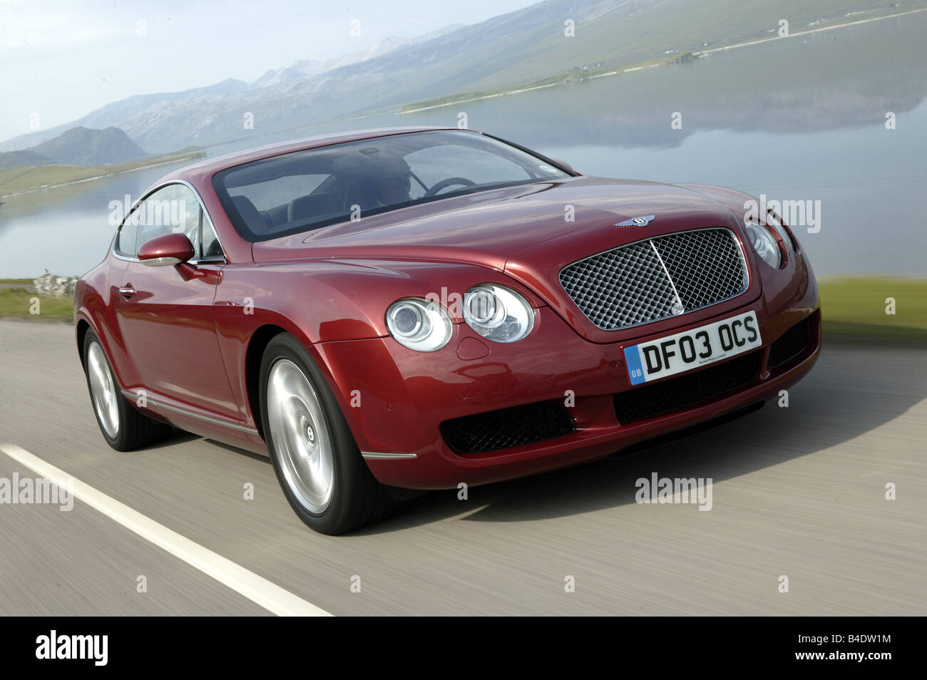 Car bentley continental gt model year 2003 coupe luxury stock car bentley continental gt model year 2003 coupe luxury approxs ruby colored driving country road diagonal from the fr vanachro Gallery