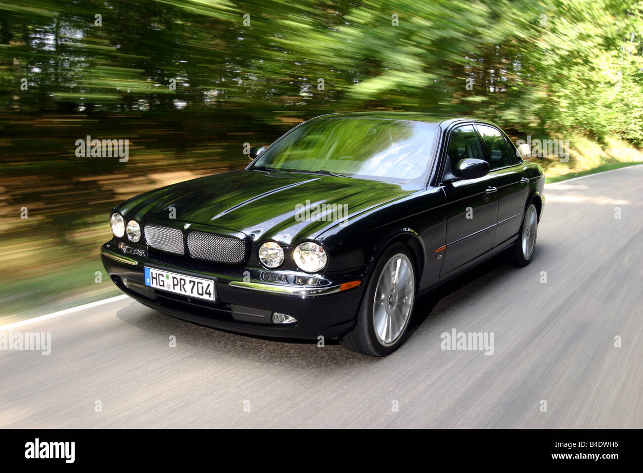Car, Jaguar XJ R, Limousine, Luxury Approx.s, Model Year 2003 , Black,  Driving, Country Road, Diagonal From The Front, Front Vie