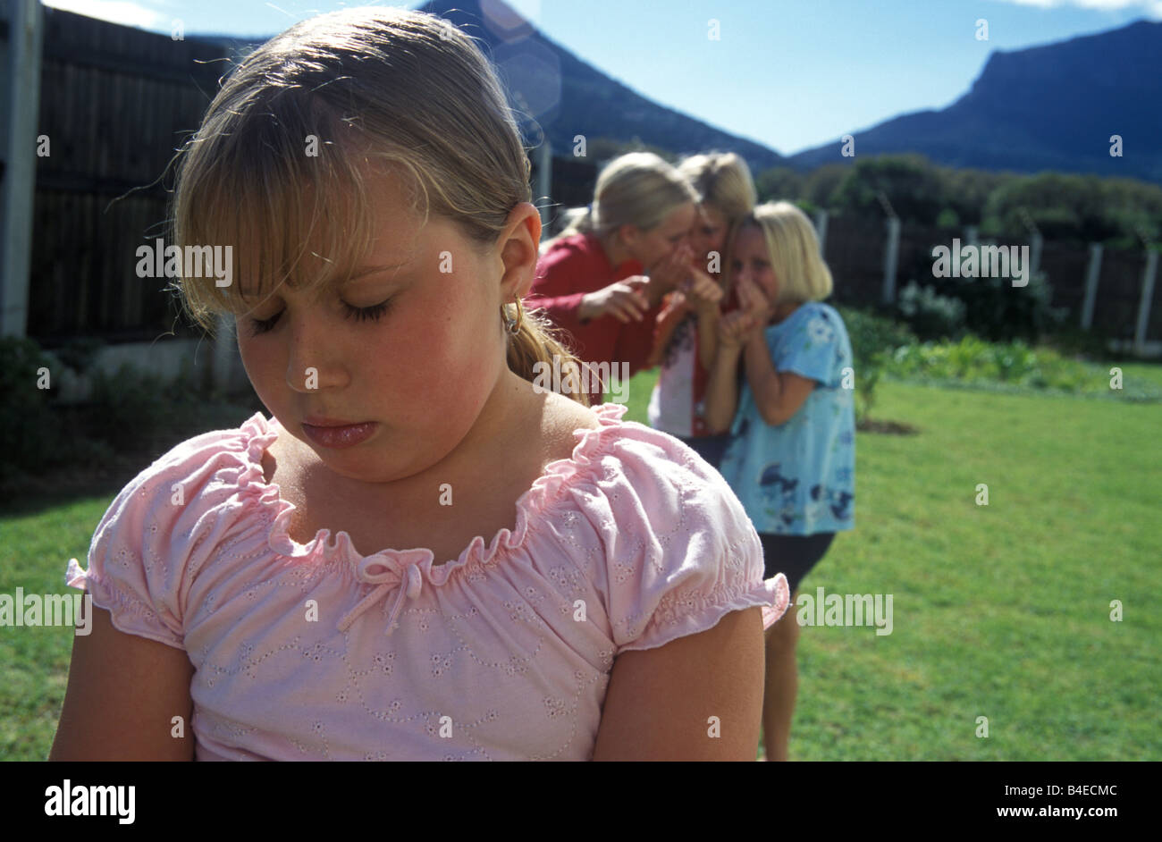 plump girls plump little girl being teased by other girls - Stock Image