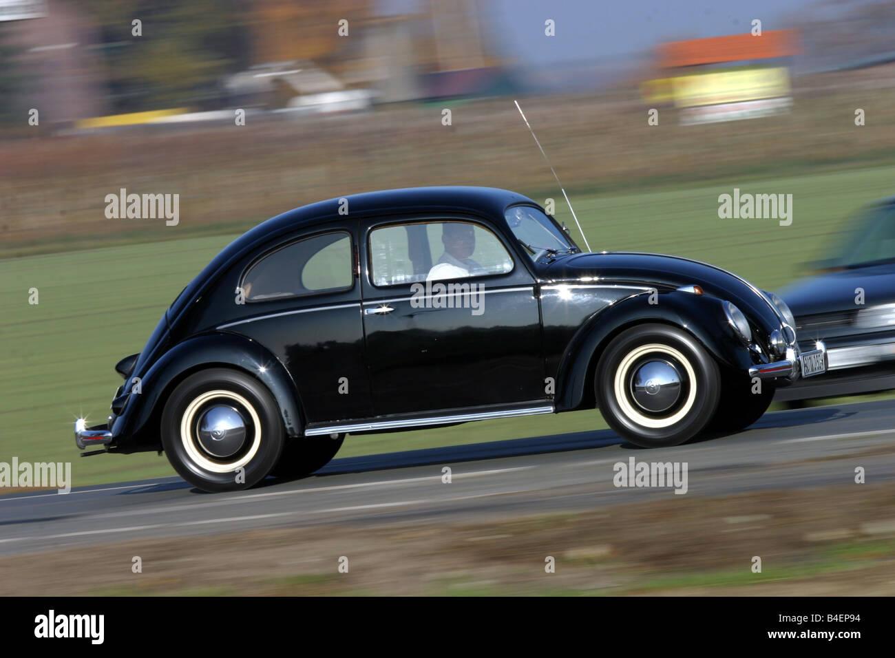 volkswagen black beetle. car, vw, volkswagen, pretzel beetle, model year 1949-1953, black, vintage 1940s, fourties, 1950s, fifties, driving, side v volkswagen black beetle
