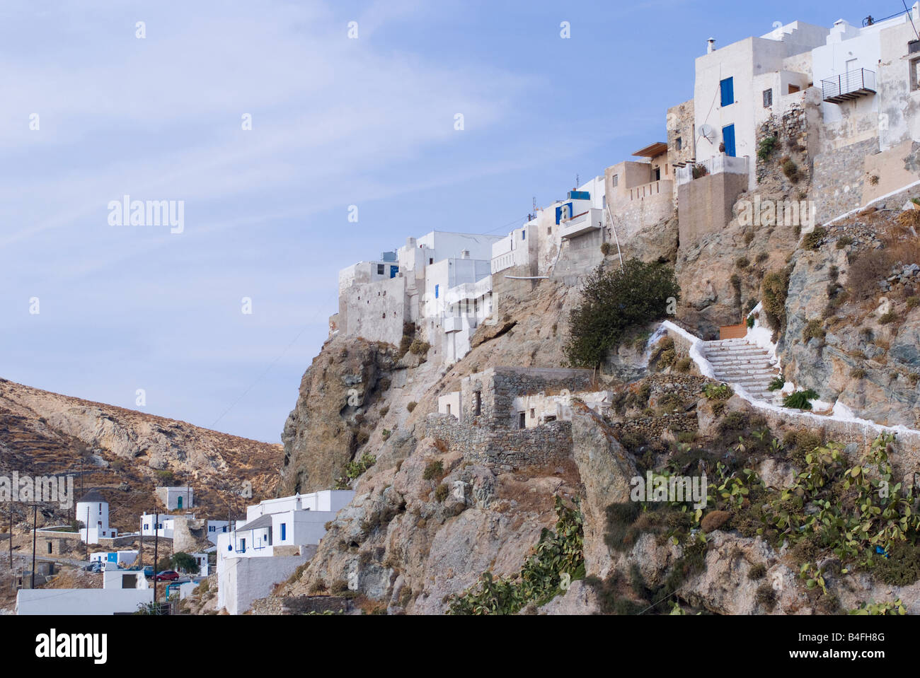 houses built into cliff top fortress in upper town chora isle of stock photo royalty free image. Black Bedroom Furniture Sets. Home Design Ideas