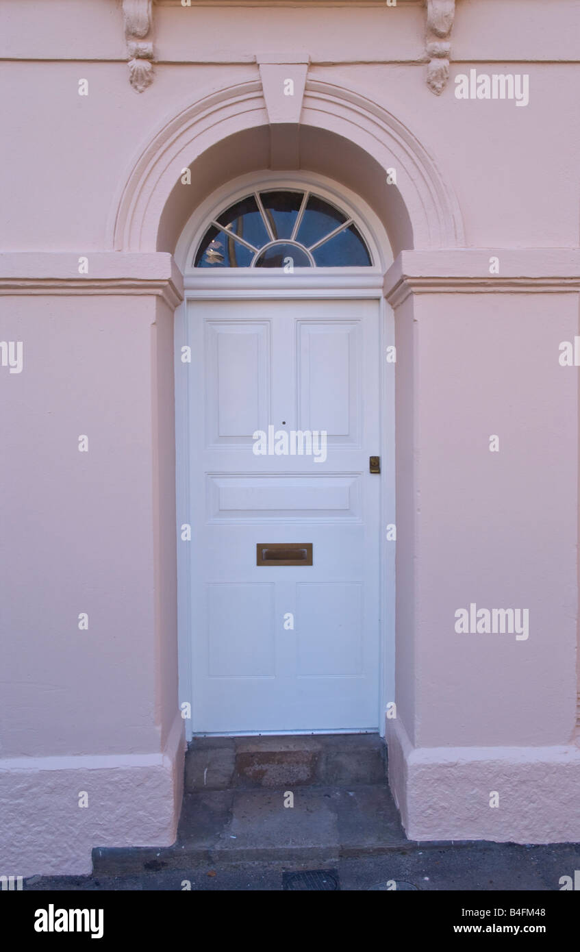 White Front Door With Semi Circular Glazed Fanlight Of