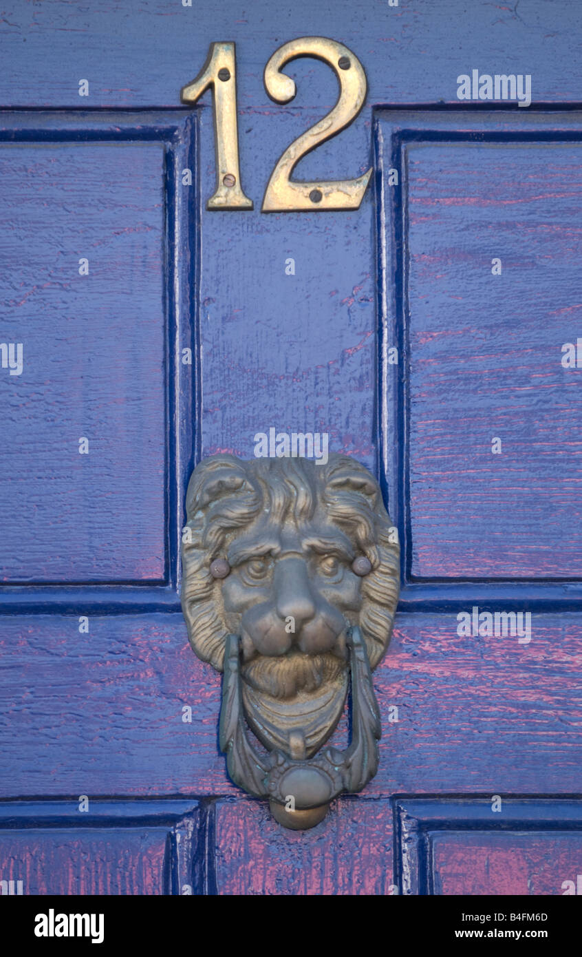 Detail Of Blue Painted Wooden Front Door Showing Number 12