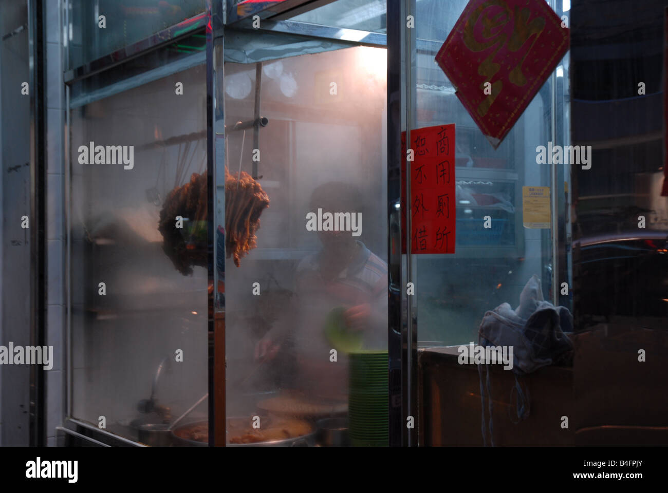 A man prepares food in a steamy kitchen in Hong Kong Stock Photo ...
