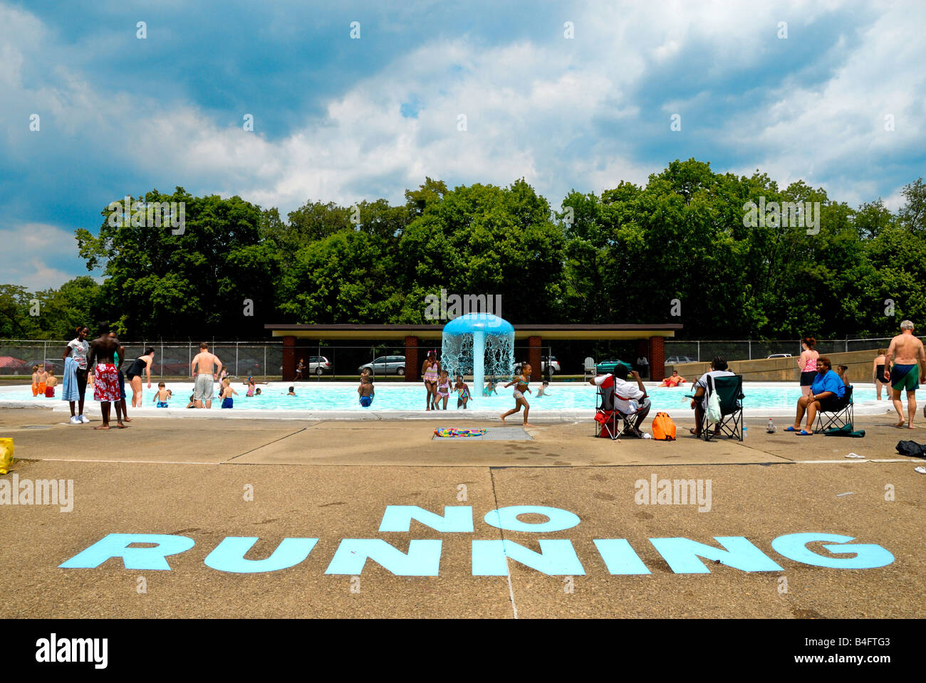 No Running Sign On The Sidewalk At The North Park Swimming Pool In Stock Photo Royalty Free