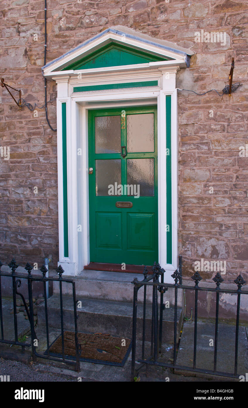 Green part glazed front door of house with white and green