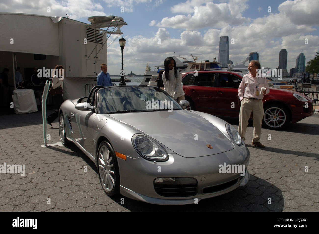 Porsche pictures of porsches : Potential customers inspect Porsches and other luxury vehicles on ...