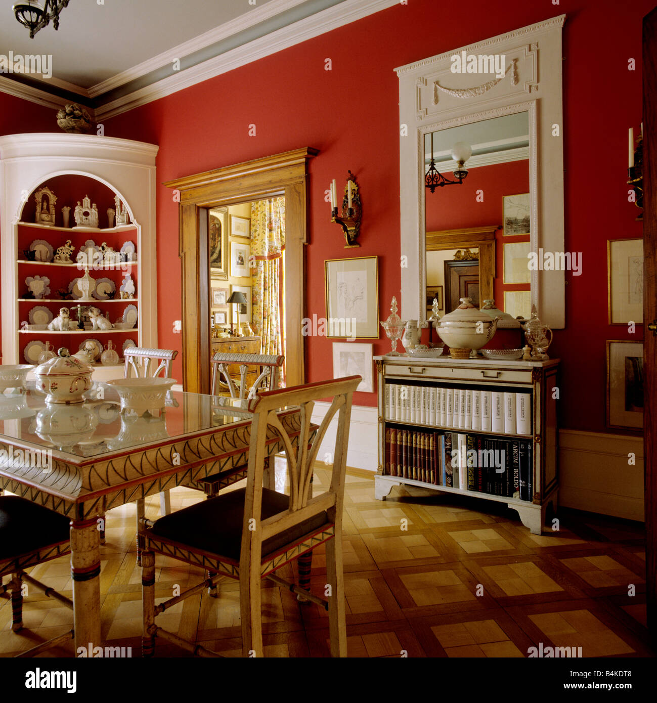 Red Dining Room With Parquet Flooring