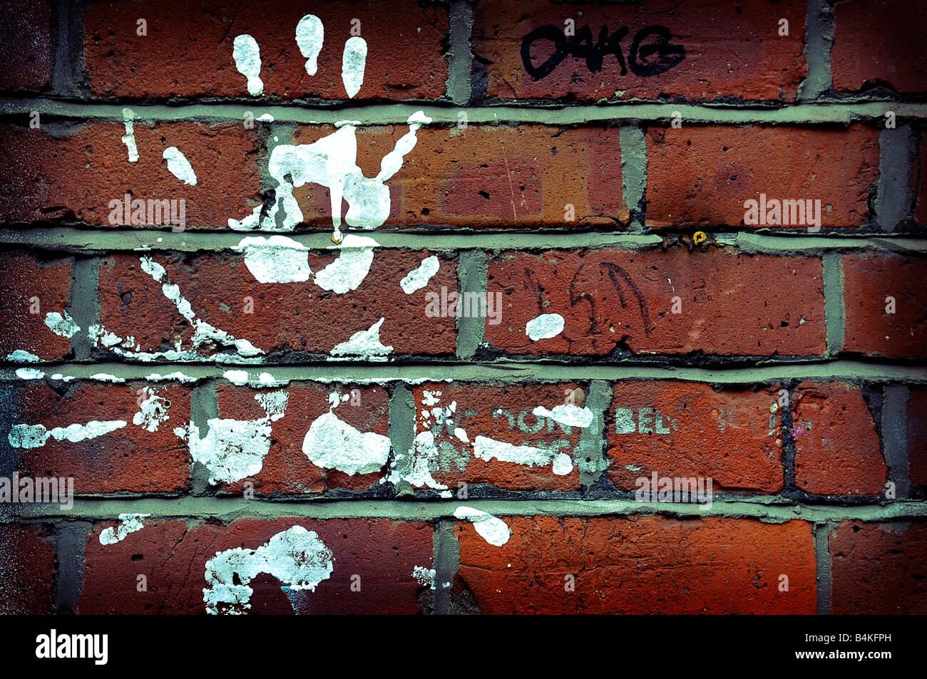 Grafiti wall red - Stock Photo White Paint Handprints Red Brick Wall Art Graffiti