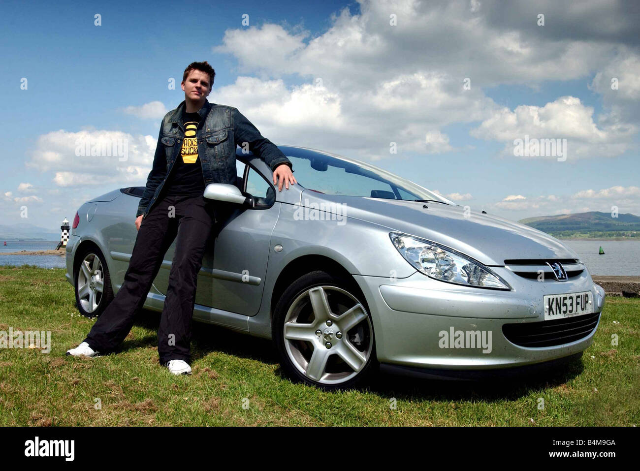 jake humphrey june 2004 bbc childrens tv presenter with a peugoet