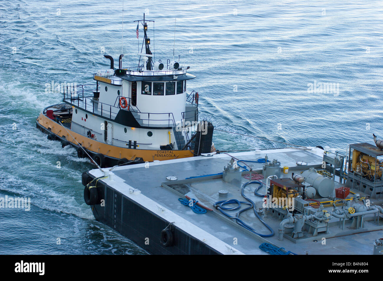 Tugboat Pushes Fuel Barge To Cruise Ship At Port In Miami Florida - Cruise ship fuel