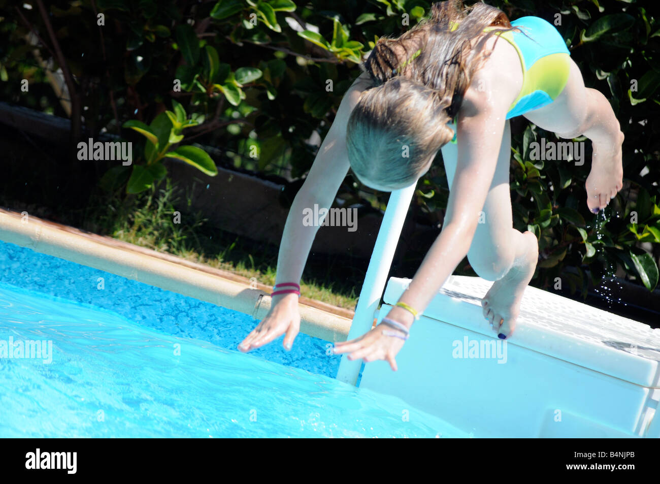 Royalty Free Photograph Of Young Girl Diving Into A
