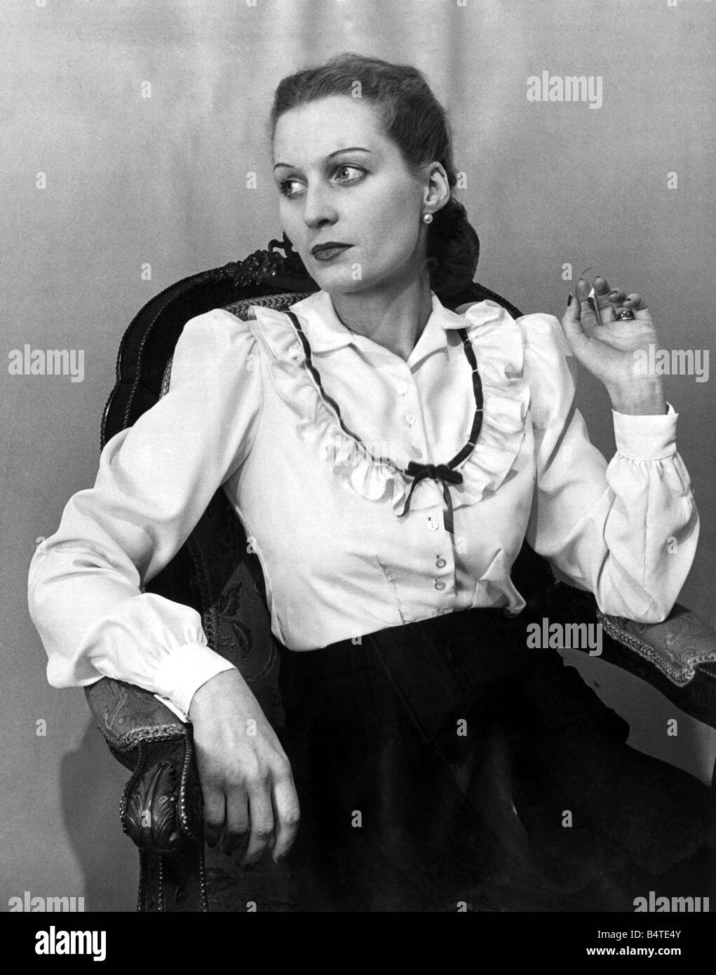 Stock Photo - Two way blouse Fashion clothing shoot January 1948 Woman reclining in chair holding smoking cigarette Model wearing washing crepe pique and ...  sc 1 st  Alamy & Two way blouse Fashion clothing shoot January 1948 Woman reclining ... islam-shia.org