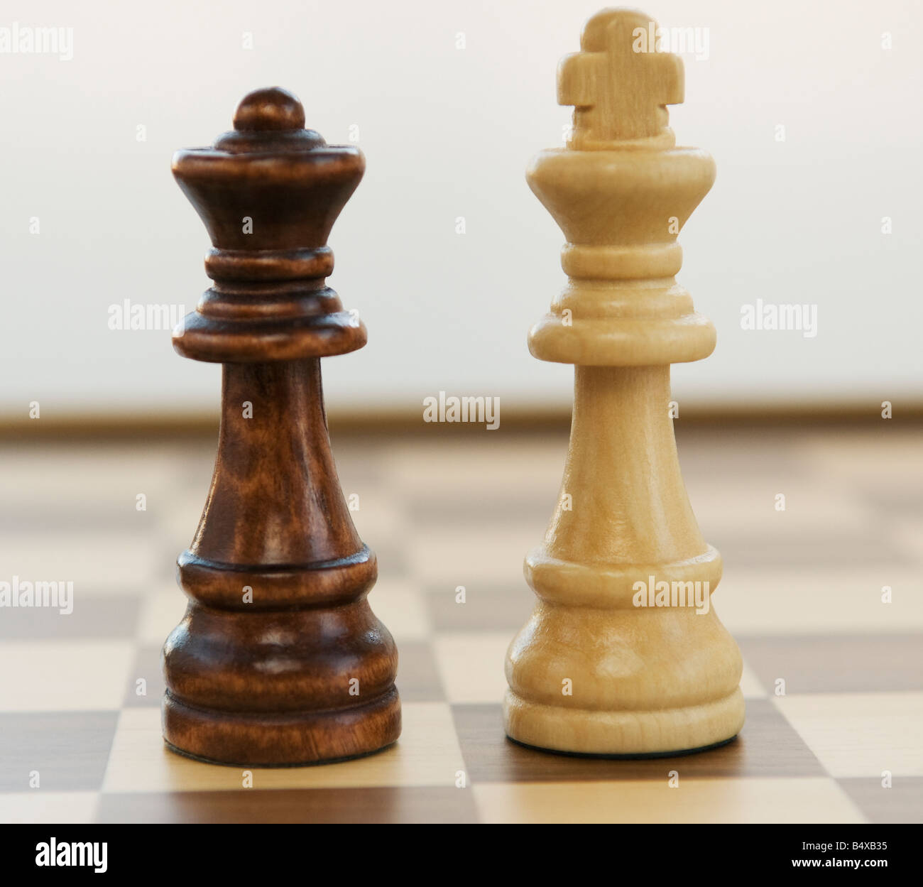 Opposing king and queen chess pieces Stock Photo, Royalty ...