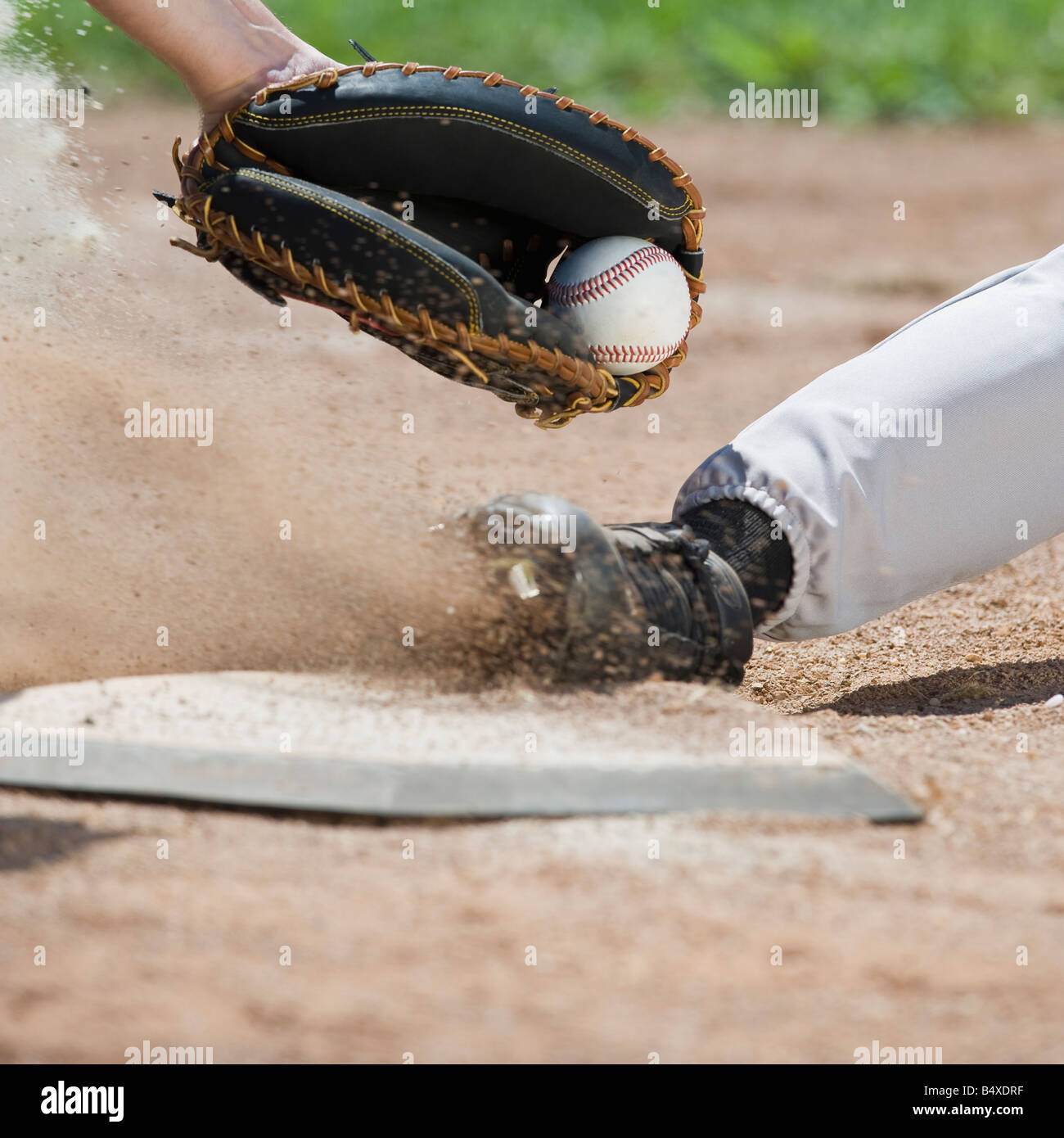 close up of baseball player sliding into home plate stock photo