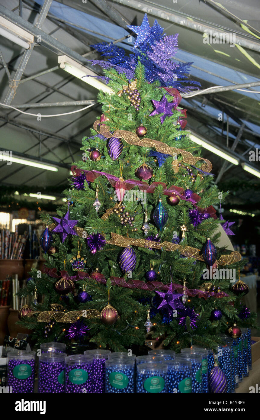 decorated Christmas tree display in a garden centre Stock Photo ...