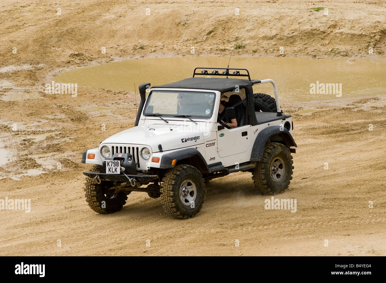 Jeep wrangler driving off road Stock Photo Royalty Free Image