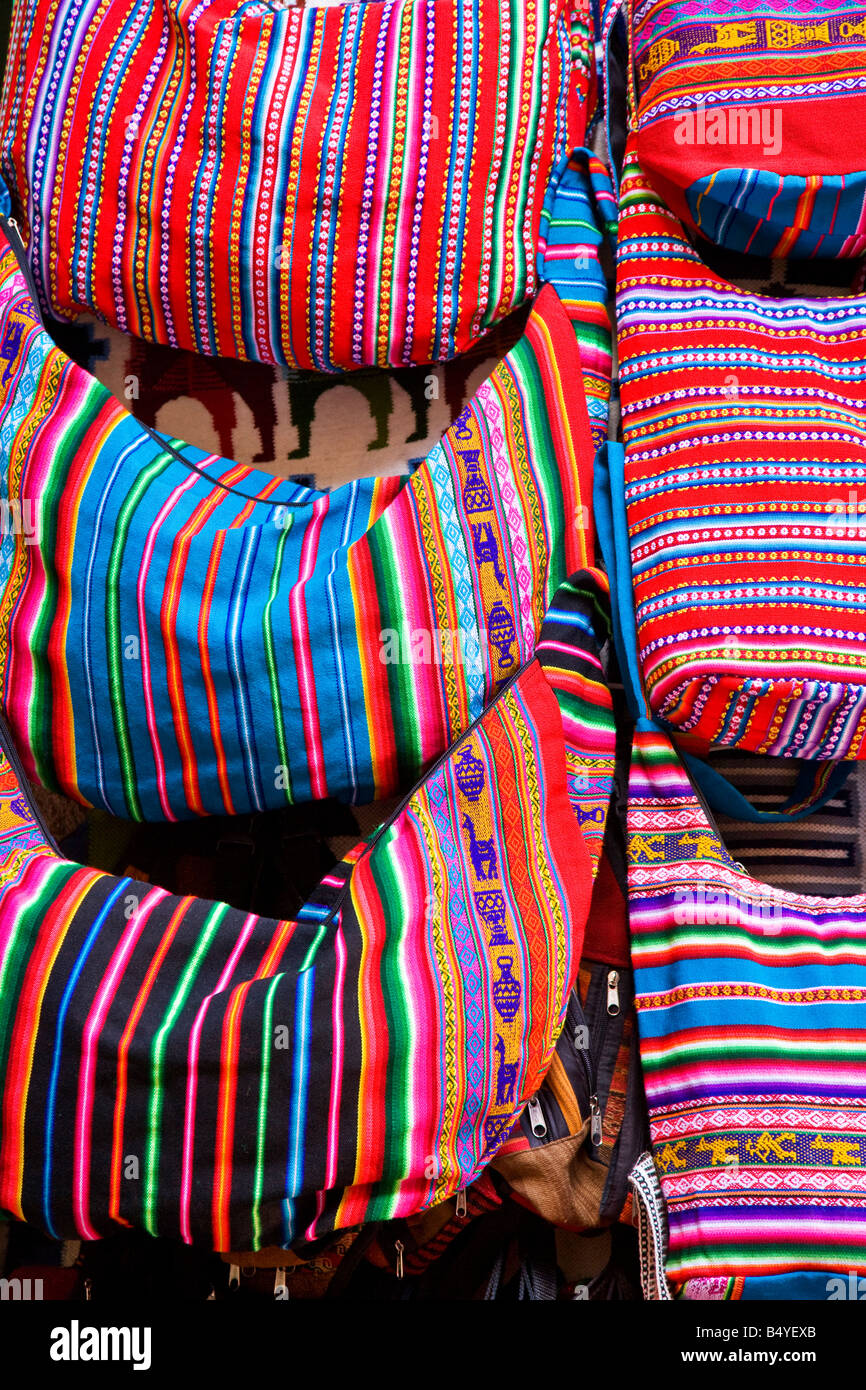 Bright, colourful shoulder bags hanging from a tourist holiday ...