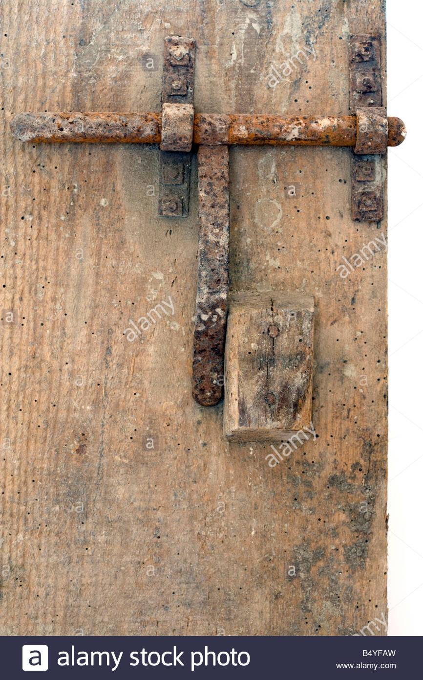 Rusty Metal Door old rusty metal bold on wooden door stock photo, royalty free