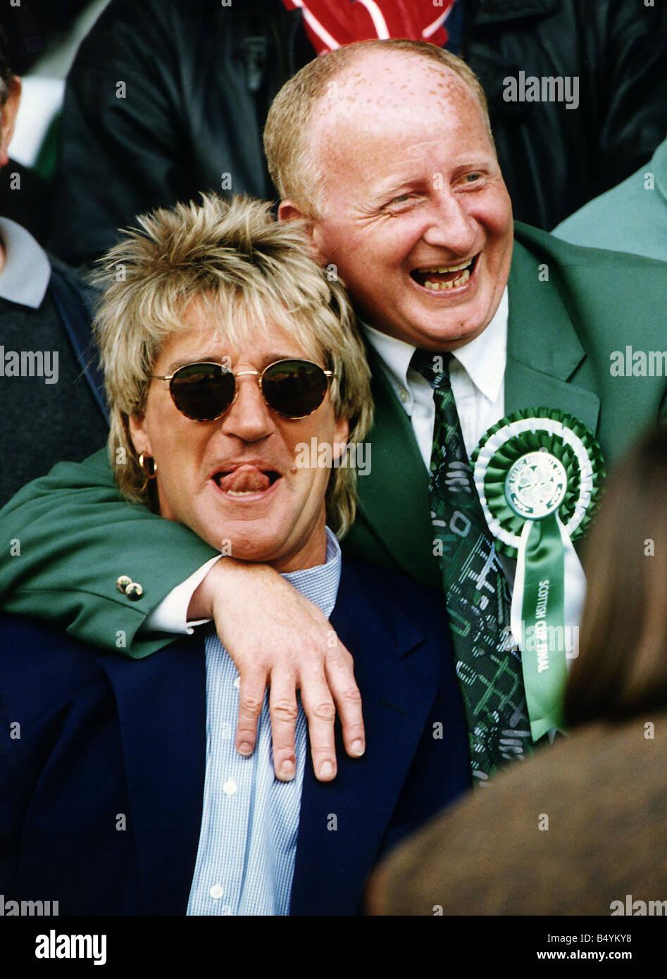 Jimmy Johnstone footballer with arm around singer Rod Stewart