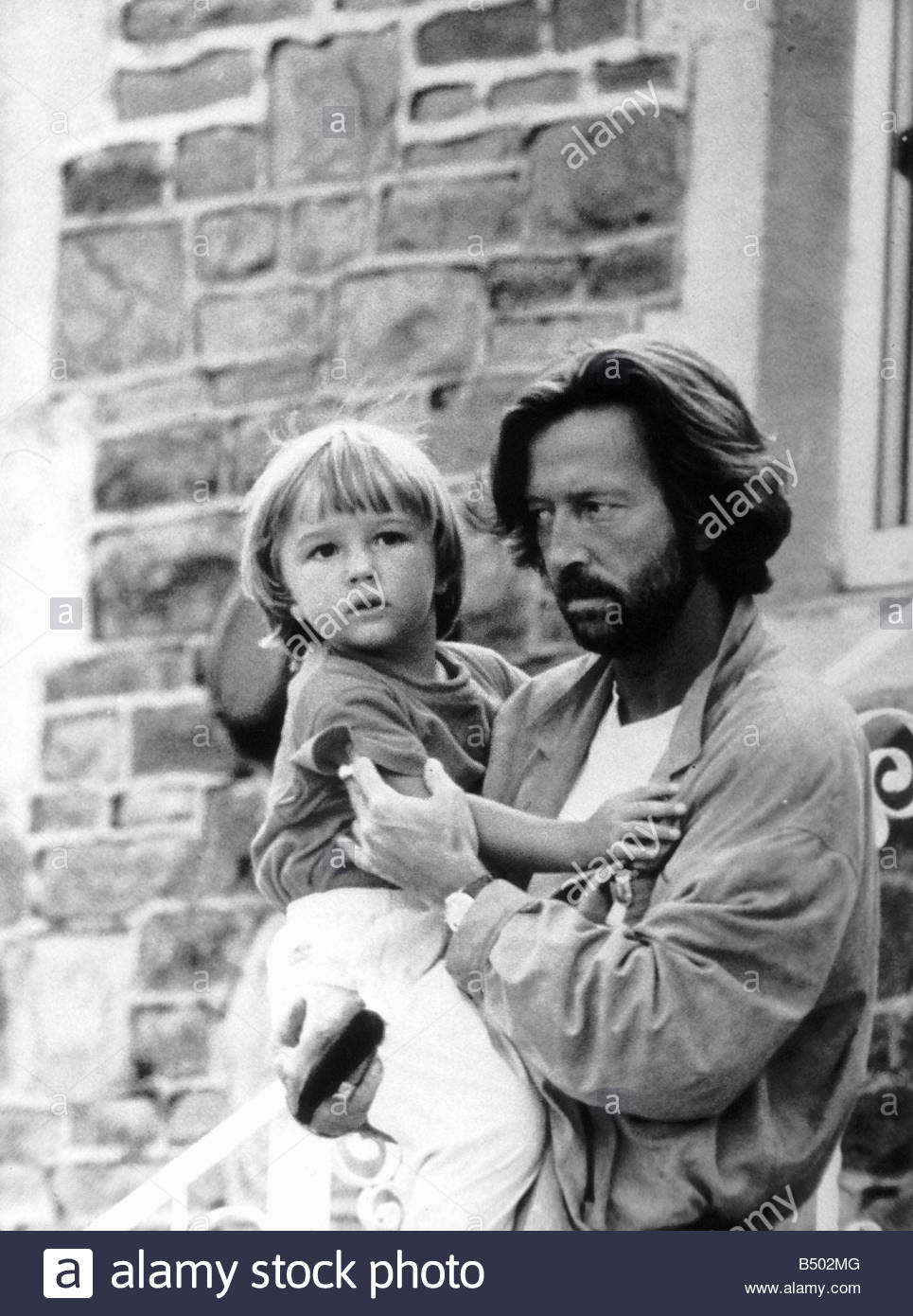 Eric Clapton singer and songwriter holds his son Conor ...
