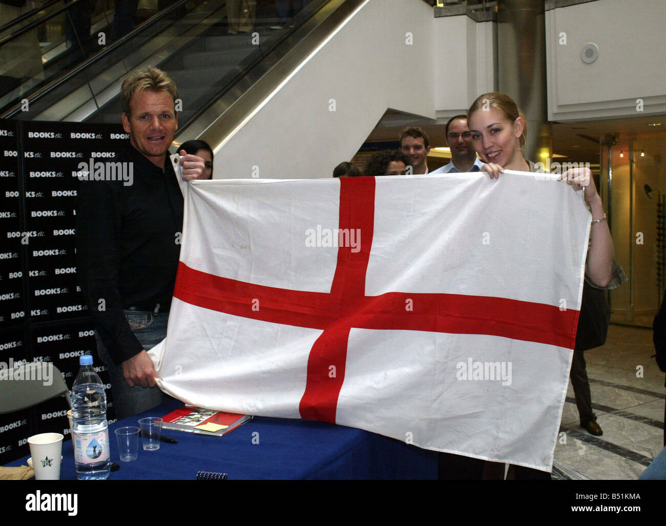 gordon ramsay signs copies of his new book at canary wharf holding stock photo royalty free. Black Bedroom Furniture Sets. Home Design Ideas